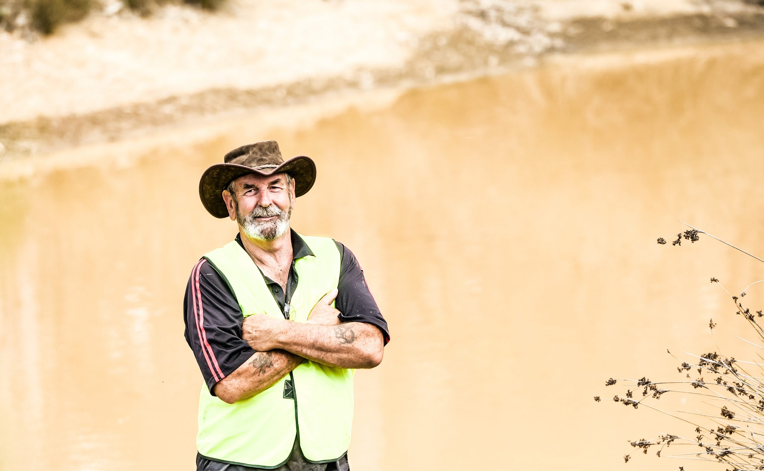 Typical Australian Farmer by his farm dam, holding water for the harsh summers. Dealing with droughts and bush fire season.